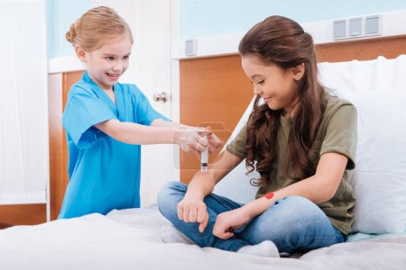 kids playing nurse and patient