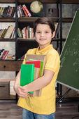 Schoolboy holding books