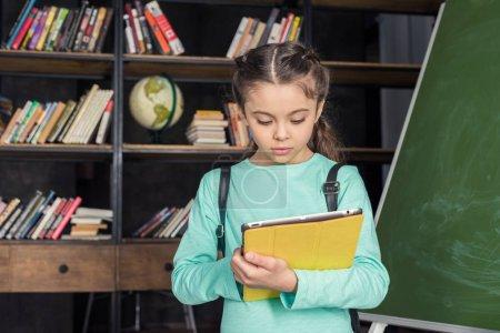 Schoolgirl with digital tablet
