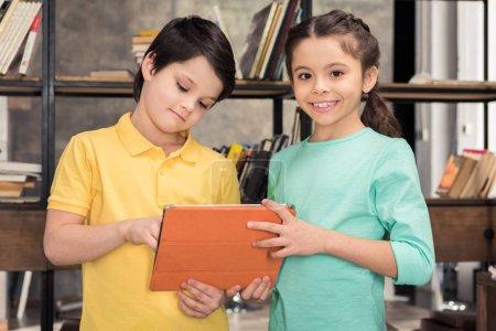 Children with digital tablet