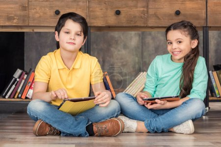children with digital tablets