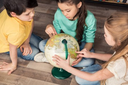 children with globe in library