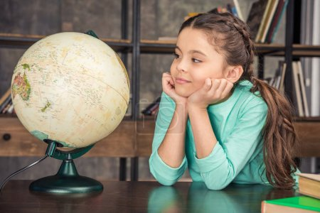 Girl with globe in library