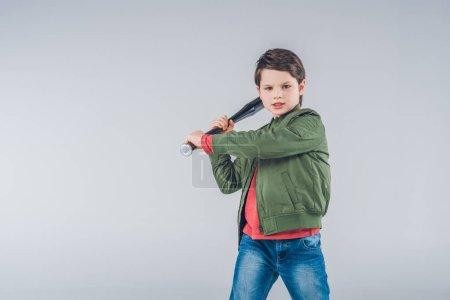 Boy brandishing baseball bat standing  isolated on...