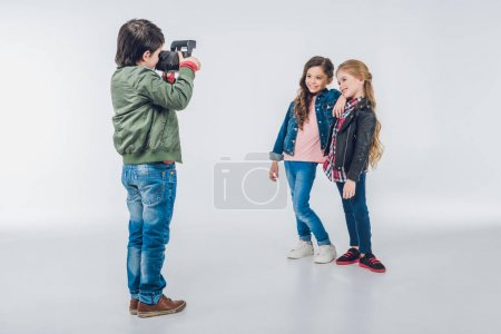 Boy photographing girls