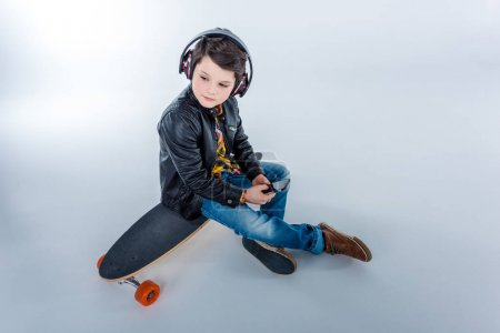 Boy in headphones with skateboard