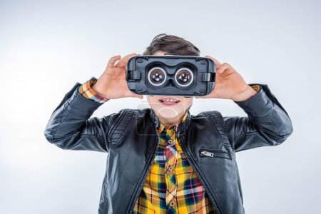 Photo for Portrait of boy wearing virtual reality headset isolated on grey - Royalty Free Image