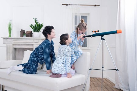 kids playing with telescope