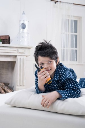 Boy using walkie-talkie