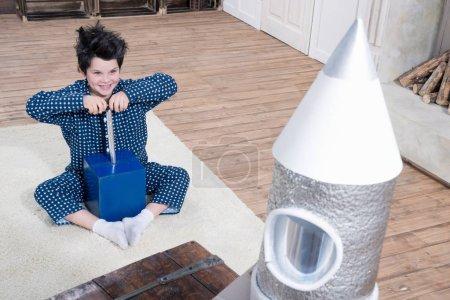 Boy launching rocket
