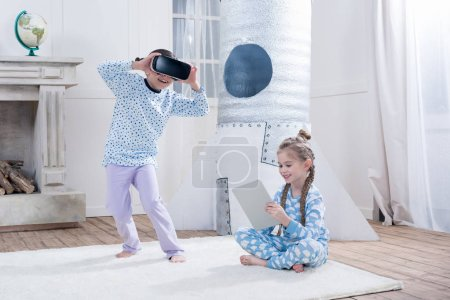 girls with VR and digital tablet