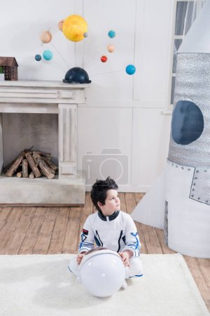 Boy in astronaut costume