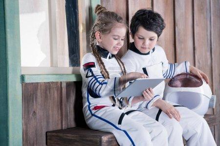 children in astronaut costumes