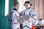 Girls in astronaut costumes