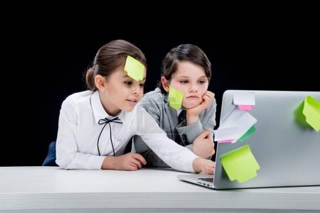 girl and boy using laptop