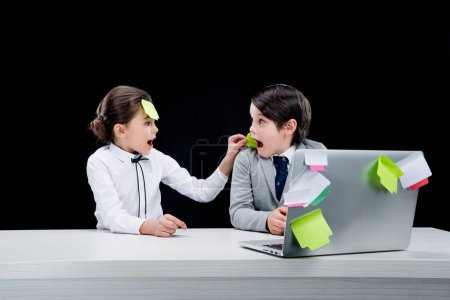 kids playing businessman and businesswoman
