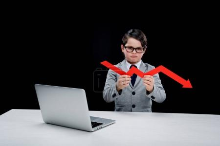 Photo for Boy with laptop and arrow at workplace  isolated on black - Royalty Free Image