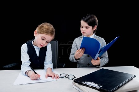 Children working with documents