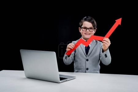 Boy with laptop and arrow