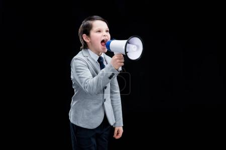 Photo for Angry Boy standing with megaphone and yelling  isolated on black - Royalty Free Image
