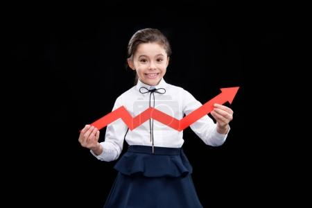 Photo for Adorable girl with red arrow  isolated on black - Royalty Free Image