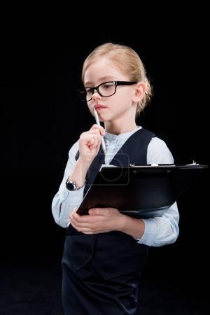 Photo pour Pensive adorable girl with folder  isolated on black - image libre de droit