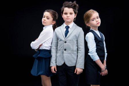 Children posing in business formalwear