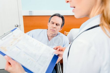 doctor holding diagnosis