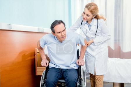 Elderly man sitting in wheelchair