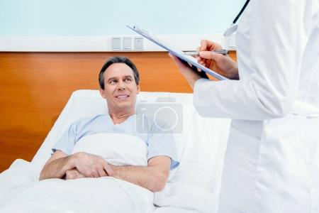 Patient and doctor with diagnosis