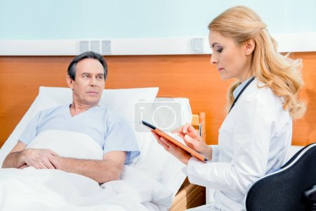 Patient and doctor with digital tablet