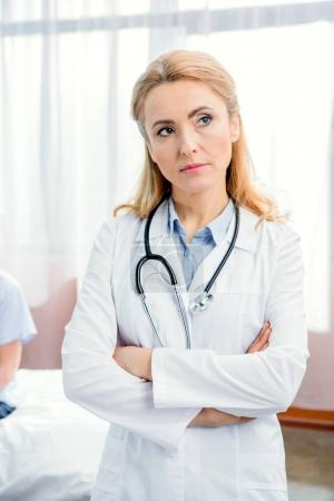 pensive doctor with stethoscope