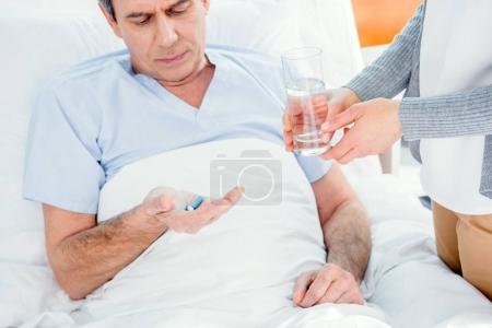man taking medicines