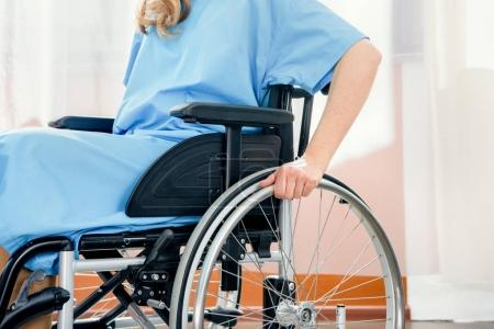 Photo for Partial view of wheelchair woman in hospital chamber - Royalty Free Image