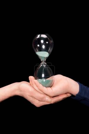 grandchild and grandmother holding hourglass