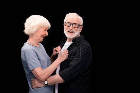 Photo for Side view of happy stylish senior couple isolated on black - Royalty Free Image