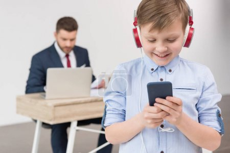 Boy listening music at office