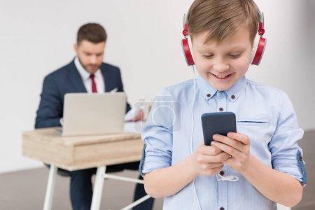 boy listening music at office