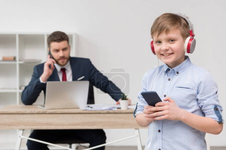 entrepreneur at office with his son