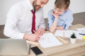 Businessman with son in office