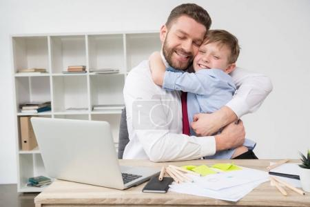 Businessman hugging with son