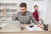 freelancer with son at office