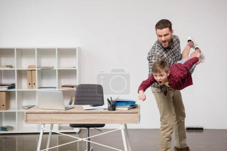 man having fun with son