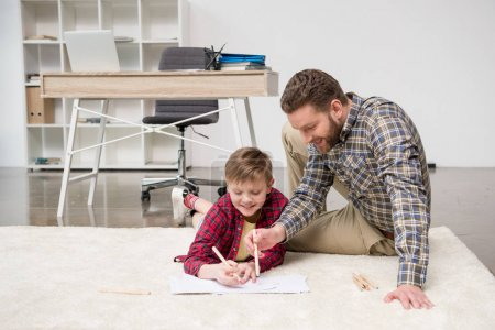 Businessman drawing with son