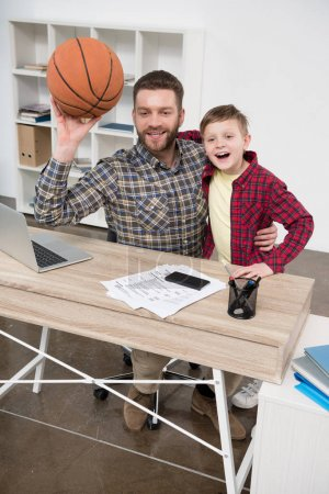 Businessman with son at home office