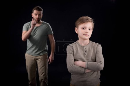 Photo for Father quarreling at indifferent son standing with crossed arms, family problems concept - Royalty Free Image