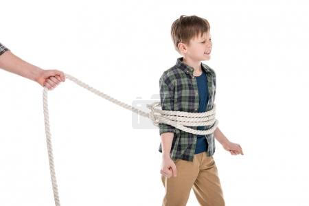 Photo for Cropped shot of father holding rope and tied little son, family problems concept - Royalty Free Image