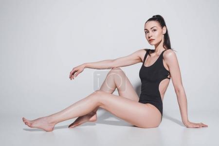 Gorgeous woman in black bodysuit