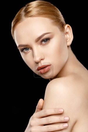 Photo pour Portrait of beautiful young seductive woman with stylish makeup looking at camera    isolated on black - image libre de droit