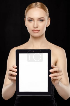 Photo for Woman showing digital tablet in hands isolated on black - Royalty Free Image